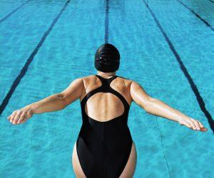 Woman Diving Into a Swimming Pool --- Image by © Royalty-Free/Corbis